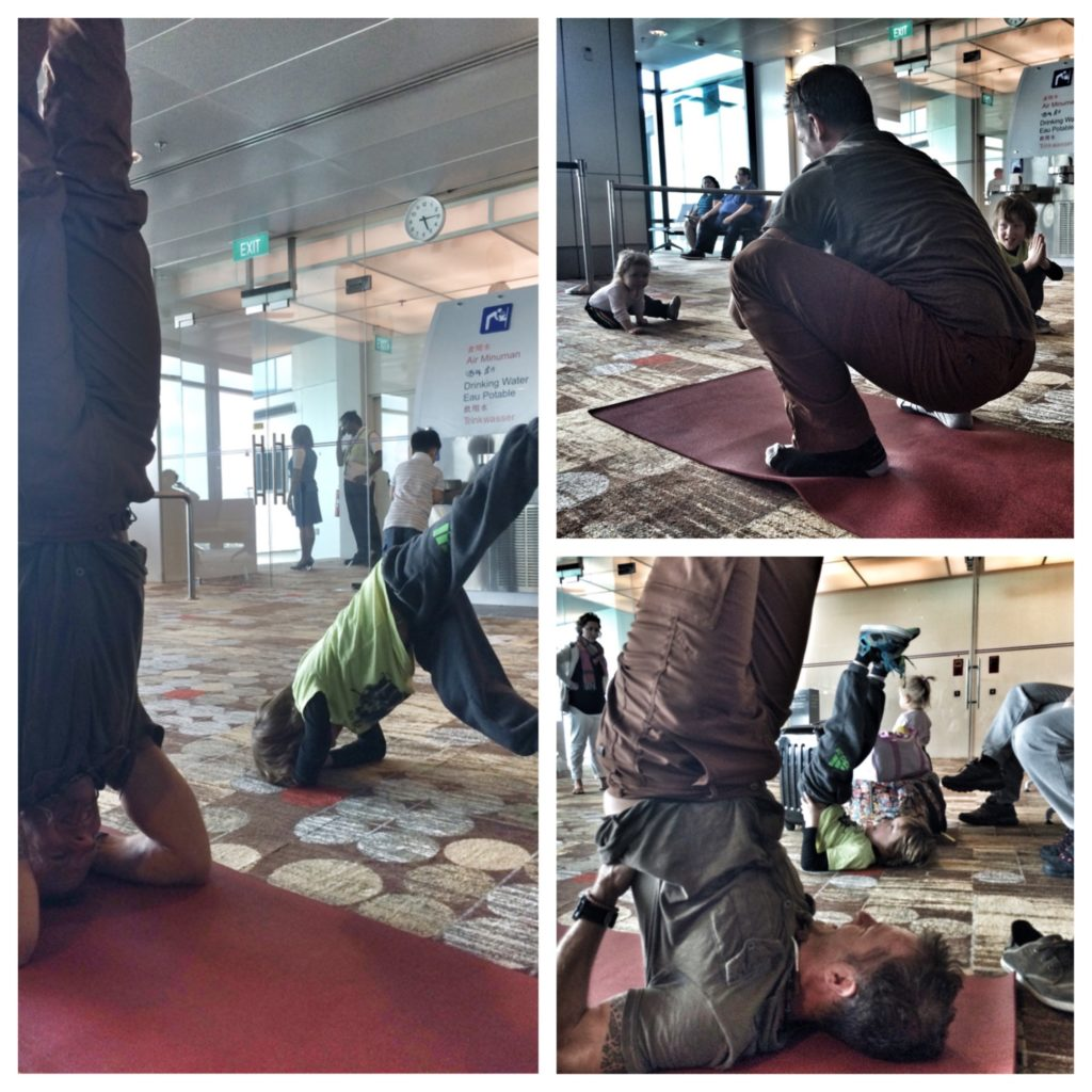 Coach Jeff Grant doing yoga in an airport in Singapore