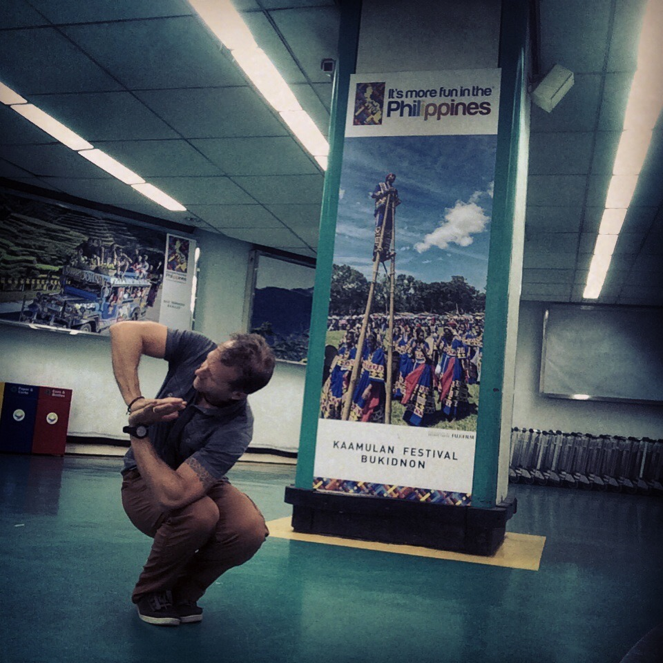 Coach Jeff Grant airport yoga practice in the Phillipines