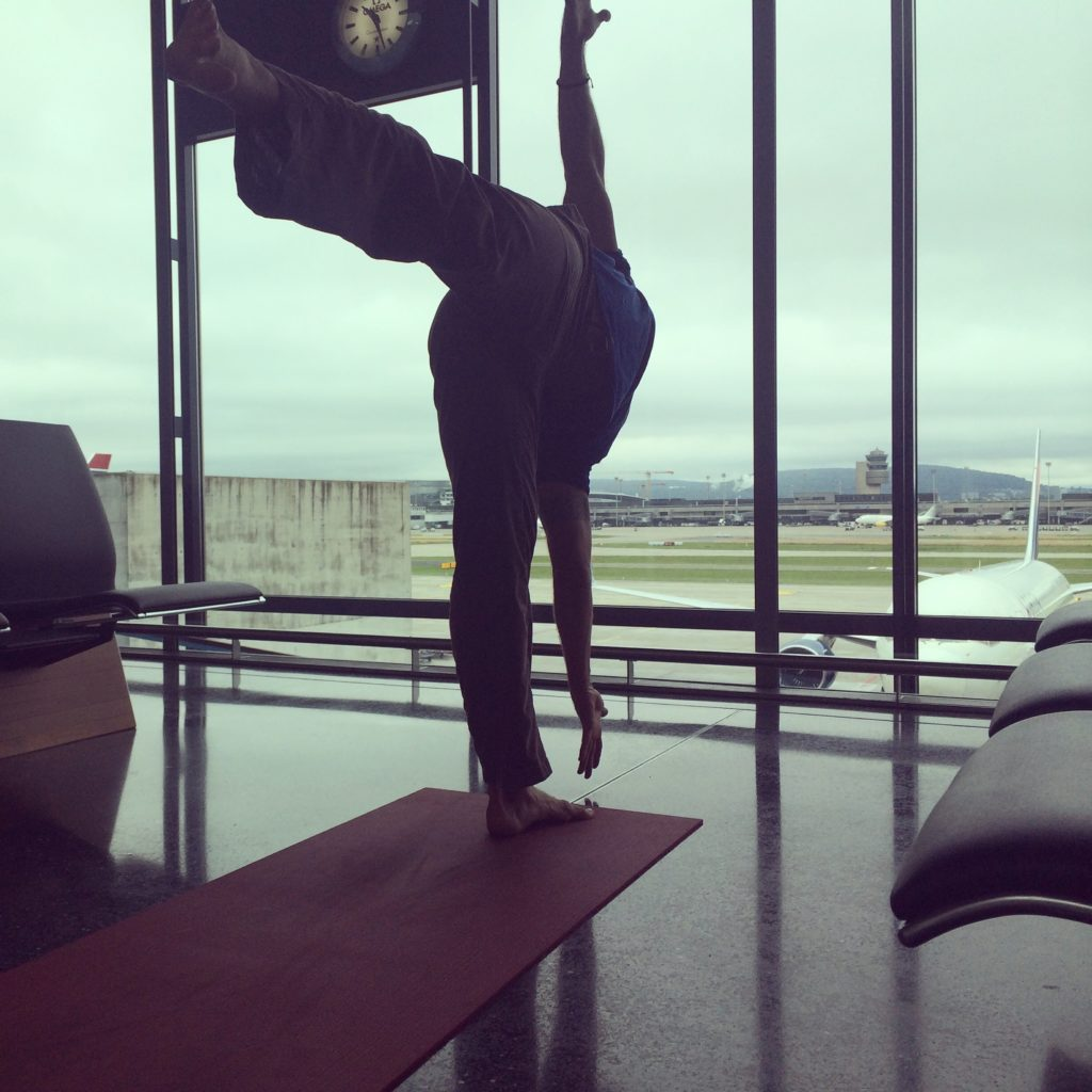 Coach Jeff Grant doing airport yoga in Zurich
