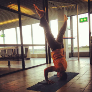 Coach Jeff Grant doing airport yoga in Amsterdam